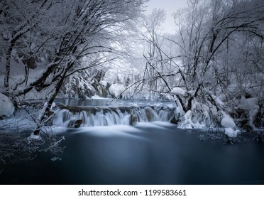 icy waterfall in the forest. In the Plitvice Lakes National Park the numerous waterfalls and rivers create beautiful landscape  of ice