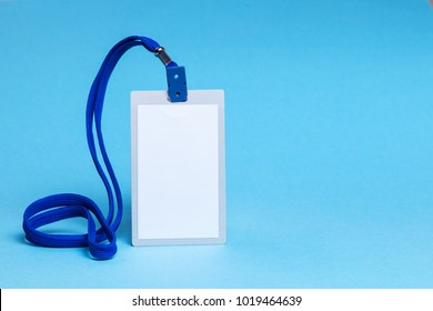 ID card badge with blue ribbon and on a blue background. mock-up. Copy space for text