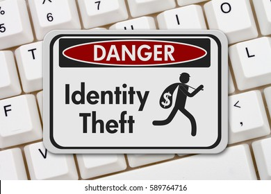 ID theft  danger sign, A black and white danger sign with text Identity theft  and theft icon on a keyboard 3D Illustration