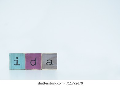 Ida. Wooden letters on white background