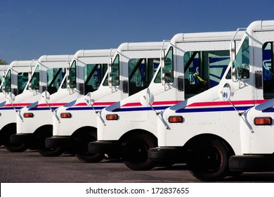Idaho Falls, Idaho Jul. 14, 2010  A row of US Postal service trucks, parked waiting to deliver the mail.