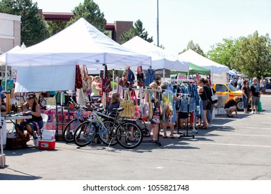 Idaho Falls, Idaho, USA Aug. 11, 2012 . Local shoppers walking through a farmer's market, buying locally grown organic produce, and handmade goods.