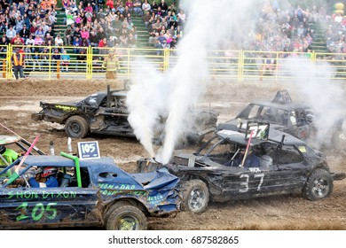 Idaho Falls, Idaho, USA August 17, 2016 Cars and drivers in a small arena compete in a demolition derby.
