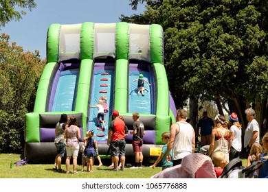 Idaho Falls, Idaho USA . Jul 4, 2016 Children playing on an inflateable slide amusemnet ride at a Fourth of July festival in a mid sized city.