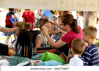 Idaho Falls, Idaho, USA July 4, 2016 Children have their faces painted at a Independence Day festival, in a mid sized US community.