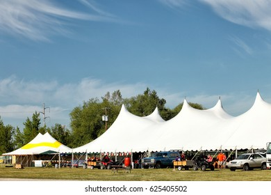 Idaho Falls, Idaho, USA June 1, 2013 The tops of a series of party tents set up for a commercial sales event.