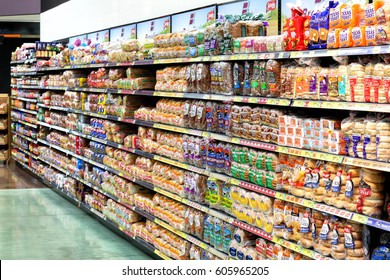 Idaho Falls, Idaho, USA June 28, 2016 The interior of a modern grocery store showcasing the bread aisle with a variety of prepackaged breads available.