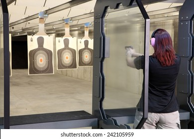 Idaho Falls, Idaho, USA Nov. 18, 2014,  Shooters practicing tactical shooting in a modern indoor gun range.