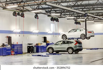 Idaho Falls, Idaho, USA Oct. 3, 2014 The interior of a modern automotive dealership maintenance garage, with hydraulic lifts, exhaust ventilation system, tool storage and energy efficient lighting.