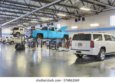 Idaho Falls, Idaho, USA, Sep, 28 2016 ,The interior of a modern automotive dealership maintenance garage, with hydraulic lifts, exhaust ventilation system, tool storage and energy efficient lighting.