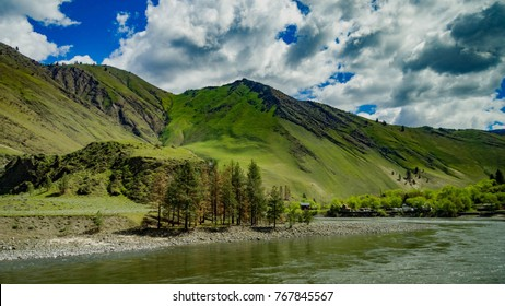Idaho River Mountainscape with blue sky and clouds