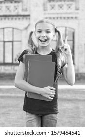 Idea comes simply and naturally to good reader. Happy little girl got idea reading book. Small cute child finger up. Identify main idea of text. Idea important in reading. School time.
