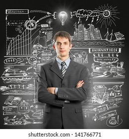Idea concept. Businessman in suit, with folded hands, looking on camera, with lamp above his head