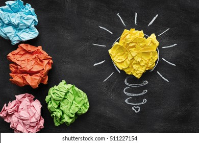 Idea concept, colorful crumpled paper on the blackboard turned into a light bulb