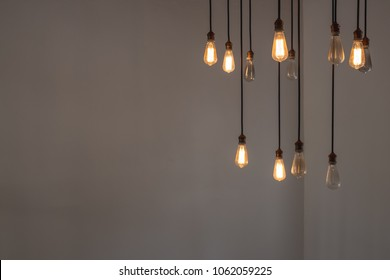 Idea concept with good and broken light bulbs hanging from ceiling