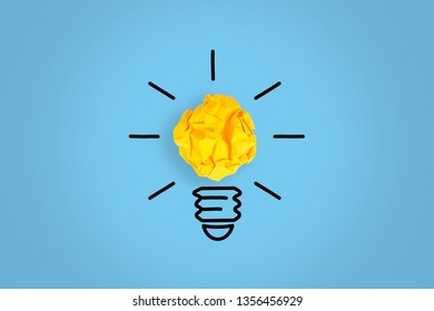 Idea Concepts Light Bulb with Crumpled Paper on Blue Background