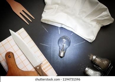 Idea for cooking food abstract concept with bulb and chef's hat in the kitchen