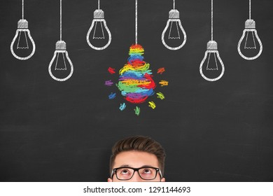 Idea creative concepts with light bulbs on a chalkboard background