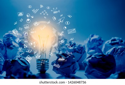 Idea and creativity concepts with lightbulb glowing and paper crumpled ball.Think of box.Business solution.performance of human