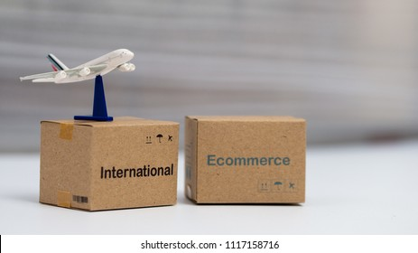 Idea International shipping and service / e-commerce concept, Logistics boxes packaging and Air courier on table. Customers can order things from via internet and shipping for worldwide.