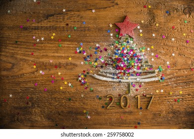 Idea of merry new year 2017 holiday Sigh symbol from many Stick Christmas green Tree a lot colorful star toys on old retro vintage style wooden texture background Empty copy space for inscription