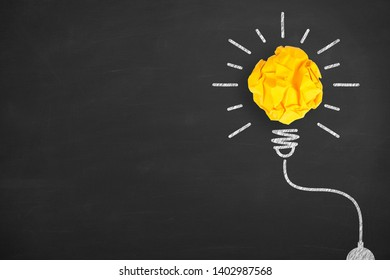 Idea Solution Concepts Light Bulb with Crumpled Paper on Blackboard Background