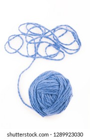 The idea is a tangled thread. Blue ball of yarn on white background