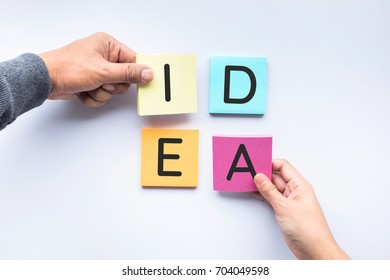 IDEA text on colorful notepaper with human hand.business concepts idea