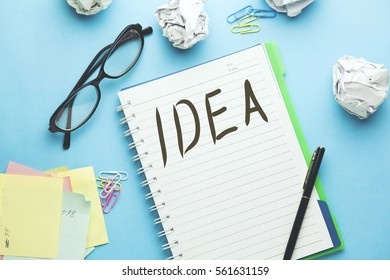 Idea text writeen on notebook with glasses