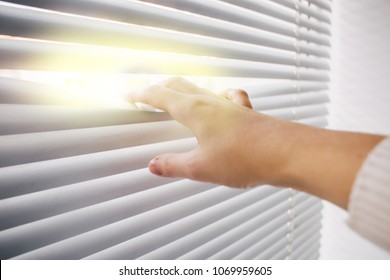 idea through window blinds, bright business ideas and concepts