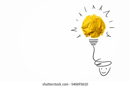 Idea with yellow crumpled paper ball ( lightbulb ) and businessman.Creative concept.
