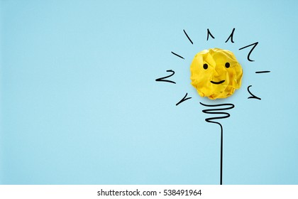 Idea with yellow paper ball ( lightbulb ) on blue background.Creative concept.