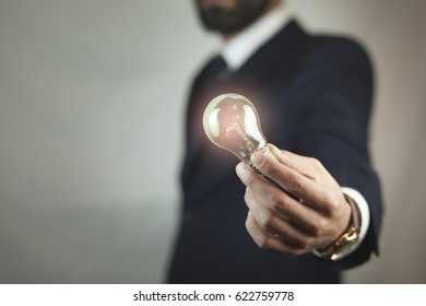 Idea,business man  hand holding light bulb