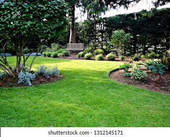 Ideal environment for tranquil moments viewing fine manicured garden landscape balance of green space in form of natural grass lawn and planted areas filled with perennials shrubs and mature trees