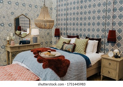 Ideal Home Show, London -  June 2019.   Cropped picture of a cozy modern bedroom