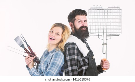 Ideal for your homemade barbecue. Bearded man and cute girl holding cooking grate. Happy couple having grill grate for grilling. Hipster and woman with grate tools. BBQ grate for barbecue party.