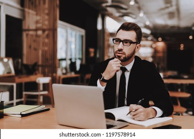 Ideas. Business Suit. Project. Laptop. Sit. Brainstorm. Young Guy. Businessman. Work. Office. Creative Worker. Businesspeople. Workplace. Inspiration. Comfortable Office. Eyeglasses. Damp Squib.