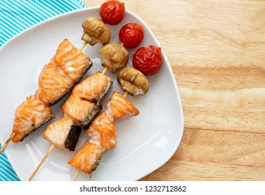 Ideas for children food, Japanese Skewered salmon  with organic mushroom and sweet tomatoes, Grilled skewers of salmon with mixed vegetables ready for grill, Healthy food for Family