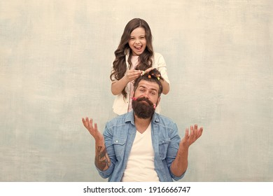 Ideas to entertain kids during quarantine. Family leisure concept. Girl dad hairdo. Quarantine with children. Happy family. Happy childhood. Upbringing happy daughter. Daughter playing with hair.