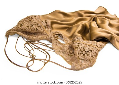 Ideas for erotic romantic Valentine's gift for women isolated on white - Luxury Gold satin silk negligee