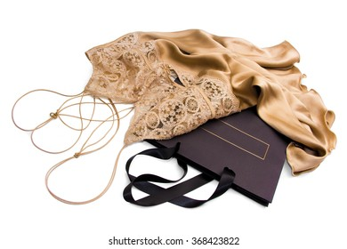 Ideas for erotic romantic Valentine's gift for women isolated on white - Luxury Gold satin silk negligee with shopping bag