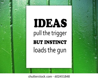 Ideas pull the trigger, but instinct loads the gun. Green metal texture background, motivatio, poster, quote, blurred image