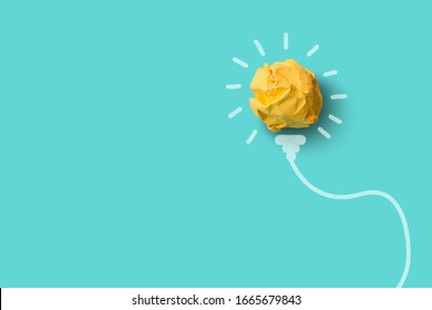 Ideas with yellow crumpled paper ball.Creative  idea concept.
