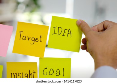 Idea,target,insight,goal, business strategy planning words on sticky note paper in hand writing, success in business concept