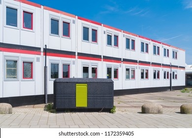 identical builder barracks on a construction site