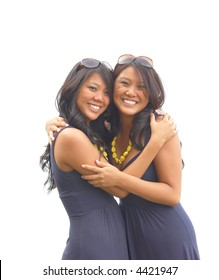 Identical twin sisters hug each other in a warm embrace