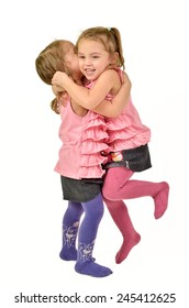 Identical twins Girls are celebrating, jumping and hugging like happy children