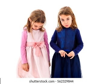 Identical twins girls are sad, lonely and moody. Children are alone,  sad and frustrated, looking at the camera
