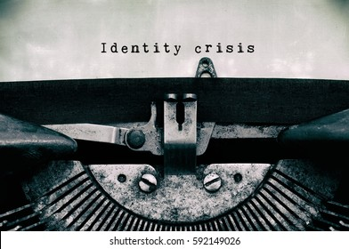 Identity crisis words typed on a vintage typewriter in black and white.