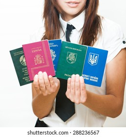 Identity documents of various countries in the hands of women managers. Various Armenian Lithuanian Ukrainian Spanish passport and residence permit in Belarus.
